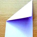 Abra a dobra e faça o mesmo com o canto esquerdo.